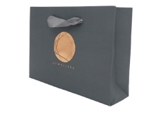 stone paper bag with custom logo, foil stamping and ribbon