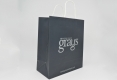 Luxury Boutique art paper bag with twisted paper handle-side view