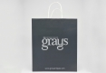Luxury Boutique art paper bag with twisted paper handle-front side view2